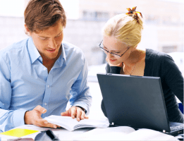 Couple reviewing reports small